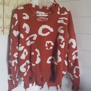 Rust colored distressed sweater